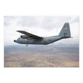 A C-130 Hercules soars through the sky Photograph
