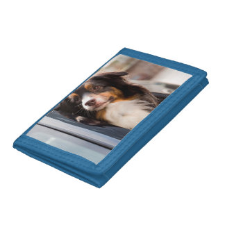 A Dog With Her Head Out of a Car Window Tri-fold Wallets