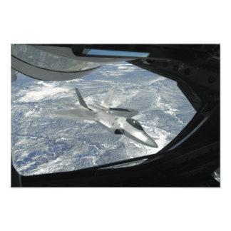 An F-22 Raptor banks away from a KC-135 Art Photo