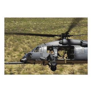An HH-60 Pave Hawk flies over the desert Art Photo