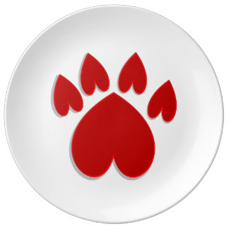 Animal paw made of hearts on white plate porcelain plates