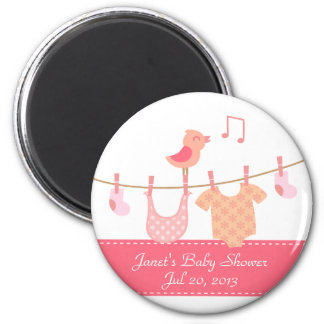 Baby clothes hanging on clothesline with pink bird 6 cm round magnet