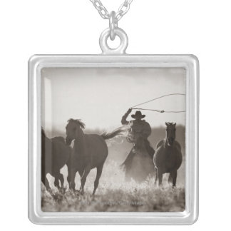 Black and White photo of a Cowboy Lassoing Horses Square Pendant Necklace