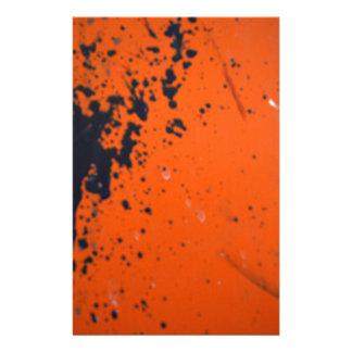 Black paint splatter on orange personalised stationery
