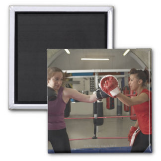 Boxer training with coach in gym square magnet