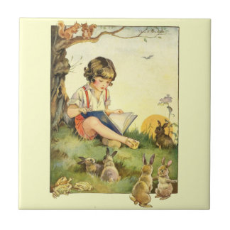 Boy reading under tree with rabbits small square tile