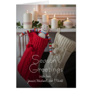 Candles lit on mantelpiece with Christmas Greeting Card