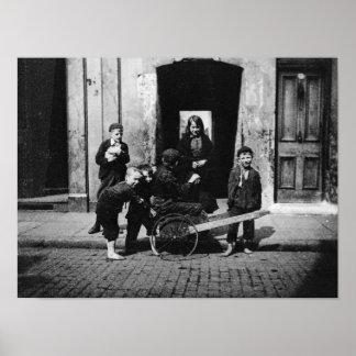 Children in a London slum Poster