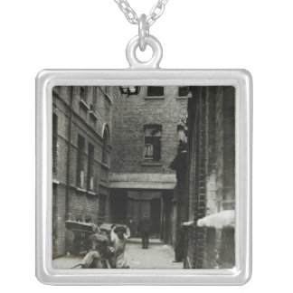 Children playing in a slum, 1899 square pendant necklace