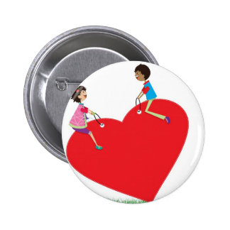 children playing on a heart shaped see-saw 6 cm round badge
