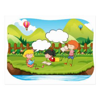 Children reading postcard