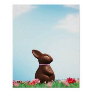 Chocolate Easter bunny amongst flowers in grass, Poster