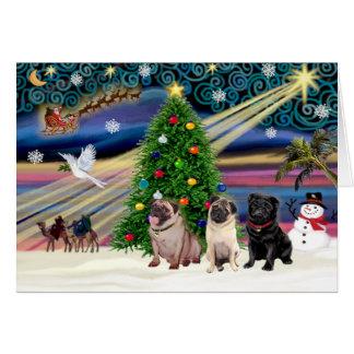 Christmas Magic Pugs (three, 2 fawn, 1 black) Greeting Card