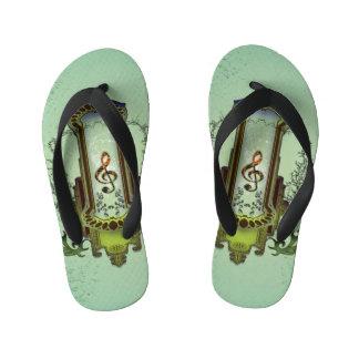 Clef on decorative button flip flops