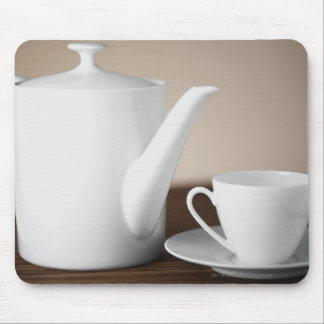 Close-up of a cup and a saucer with a tea kettle mouse pad