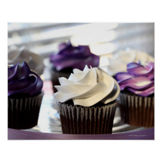 Close-up of cupcakes with selective focus on poster