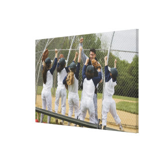 Coach with baseball team stretched canvas prints