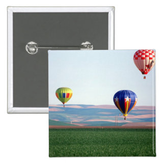 Colorful hot air balloons float over wheat 15 cm square badge