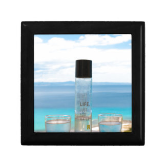 Cool water filled bottle and glasses small square gift box
