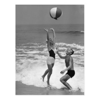 Couple Playing with a Beachball Postcard
