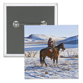 Cowboy riding a horse on the range on The 15 Cm Square Badge