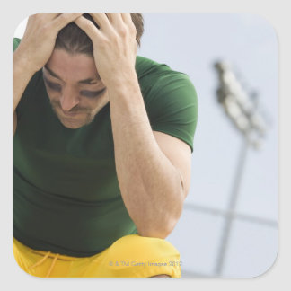 Defeated Football Player with Head in Hands Square Sticker