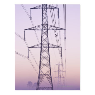Electricity pylons in mist at dawn. postcard