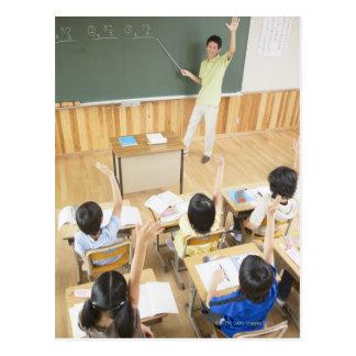 Elementary school students at school postcard