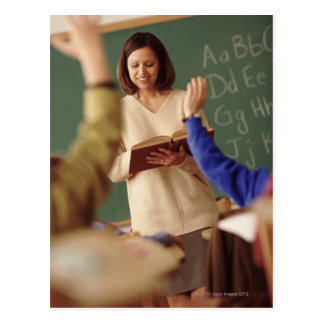 Elementary school students raising their hands postcard