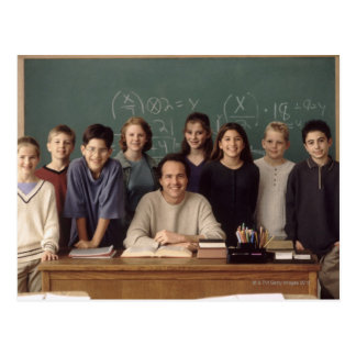 Elementary school students standing behind postcard