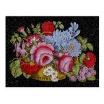 Floral basket on black marble background postcard