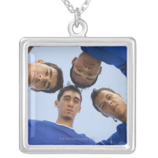 Football players huddled together square pendant necklace