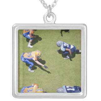 Football players playing football square pendant necklace