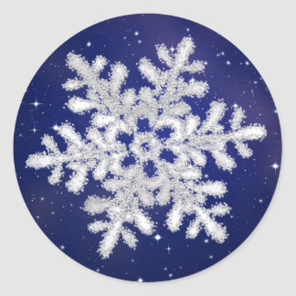 Glittering silver white snowflake on night sky round sticker
