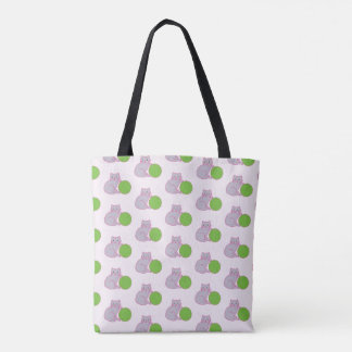 Grey kitten with green ball tote bag. tote bag