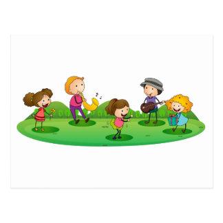 kids playing music postcard