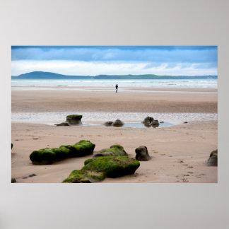 lone girl walking near unusual mud banks poster