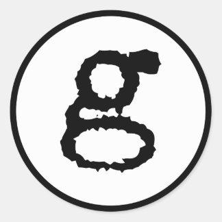 lowercase letter g in black round sticker