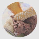 Mixed ice cream scoops with biscuits in bowl round sticker