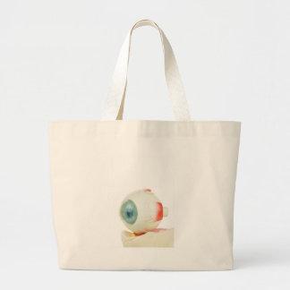 Model human eye isolated on white background.jpg jumbo tote bag