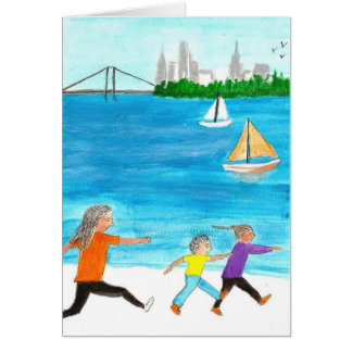 Mother chasing her two kids on beach greeting card