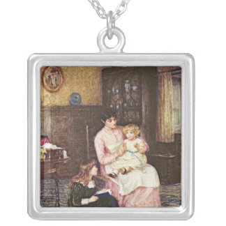 Mother playing with children in an interior square pendant necklace