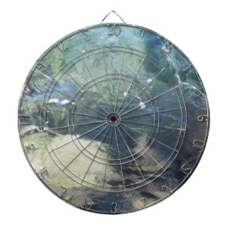 Nature background of transparent sea water flowing dartboard with darts
