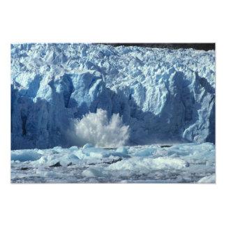 Newly-calved iceberg splashing into chilly photo