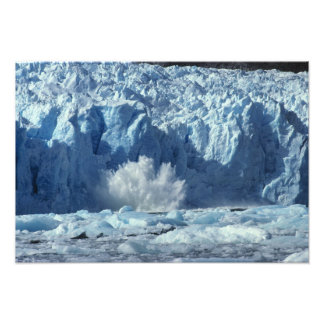 Newly-calved iceberg splashing into chilly photograph