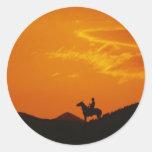 Orange Sunset with Cowboy Silhouette Round Sticker