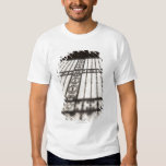 ornate iron fencing shadow on tile floor tshirts