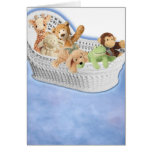 Plush toys in moses basket greeting card