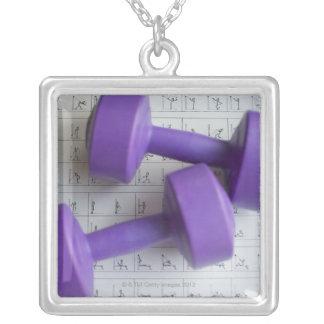 Purple dumbbells. square pendant necklace