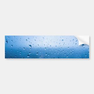 Rain drops on a window glass bumper sticker